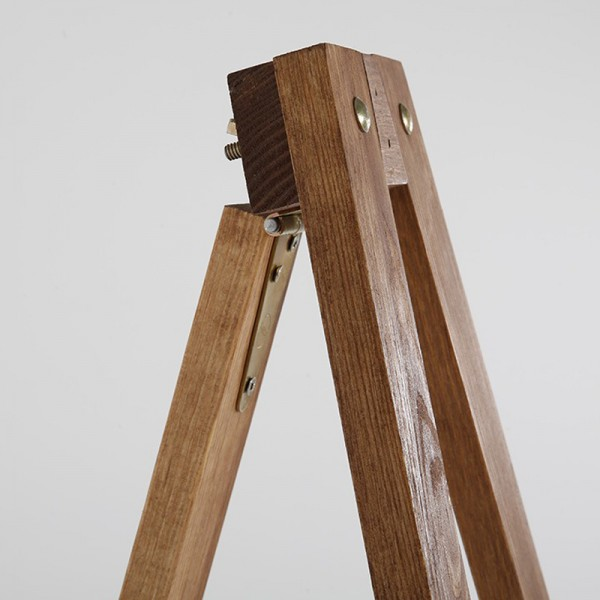 Hinged easel legs fold flat when not in use