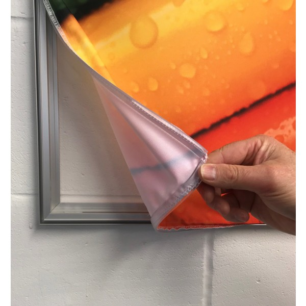 Fabric graphic with silicon edge pushes in recessed groove