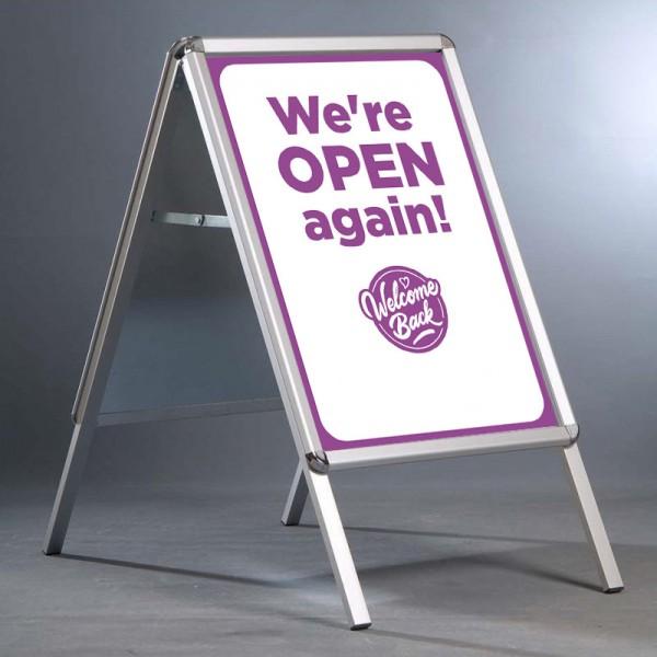 Shop open again pavement sign - pink
