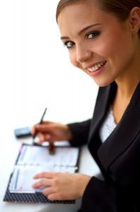 bigstock_Young_Businesswoman_Organizing_919547